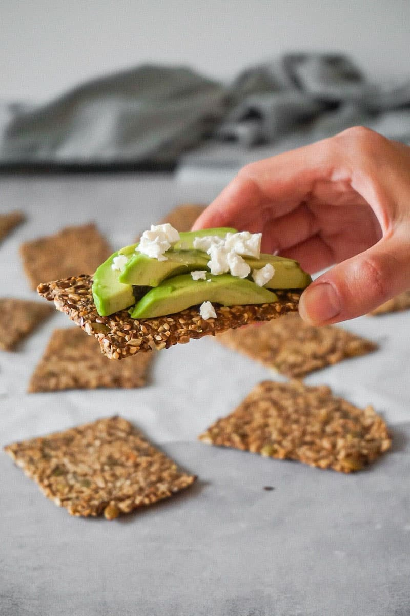 Keto seed cracker with avocado and feta cheese