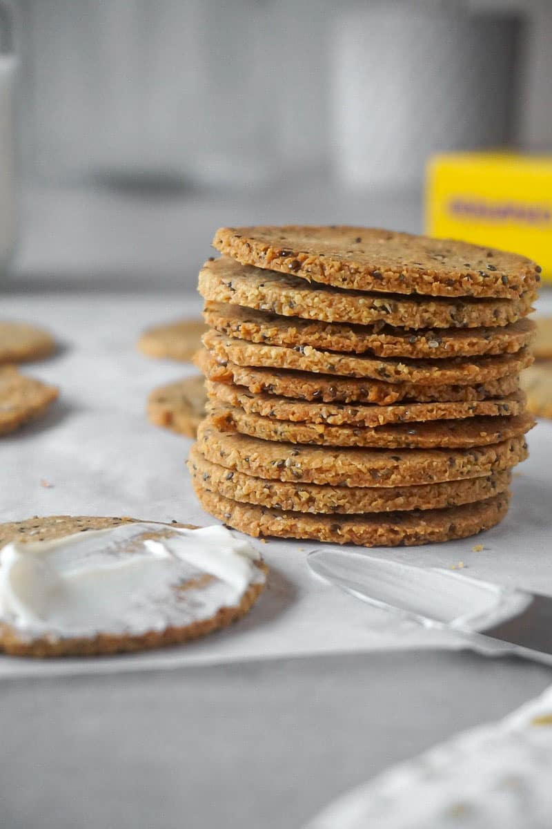 Low carb crackers made with almond flour and chia seeds served with cream cheese.