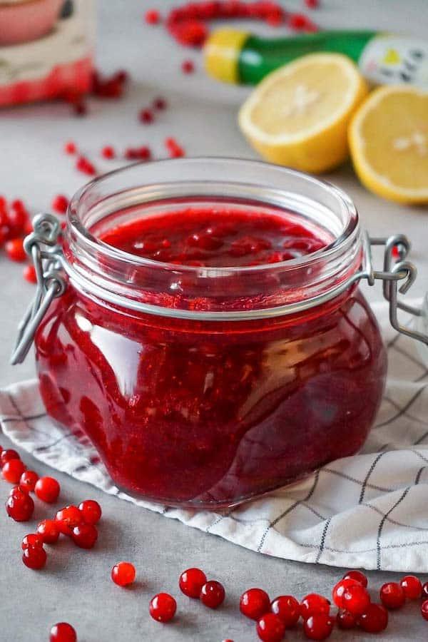 Cranberry sauce in an open, glass jar