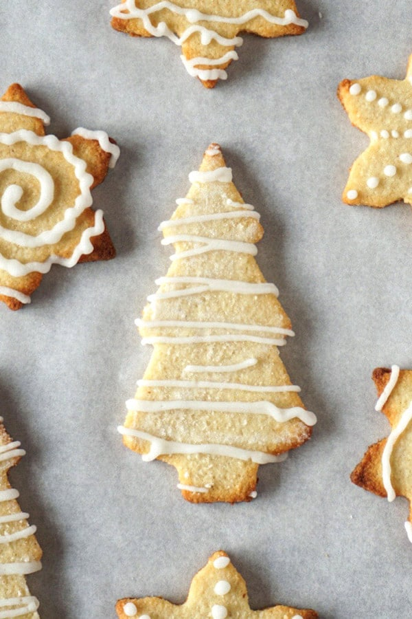 Keto cut-out cookies decorated with white royal icing.