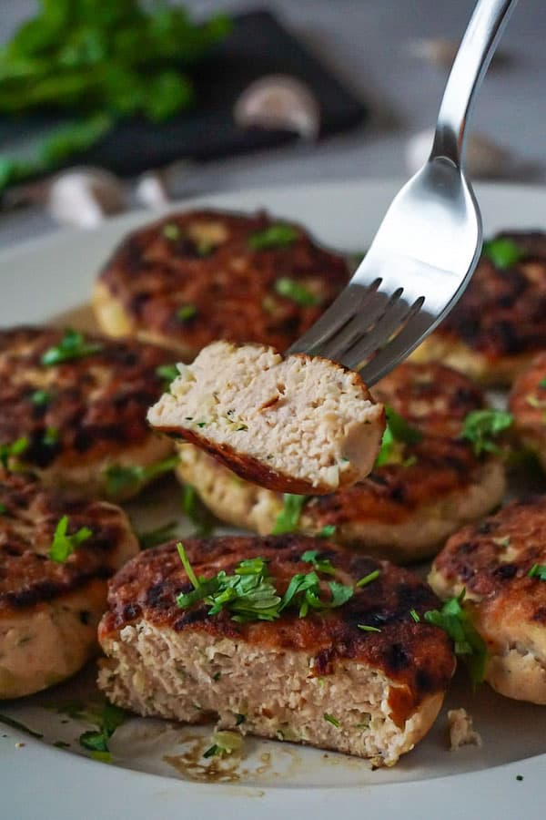 Palte full of salmon cakes made with coconut flour.