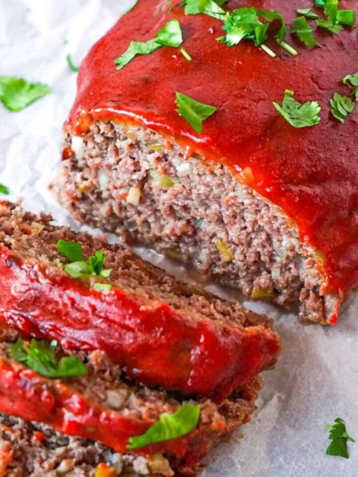 Close up picture of sliced low carb meatloaf garnished with chopped cilantro.