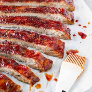 Close up shot of a freshly baked pork spare ribs, sliced with bbq glaze on.