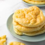 Close up shot of a small round plate with cloud bread rolls on it.